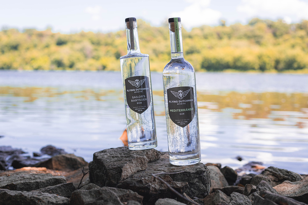 Gin and Rum sitting by the water