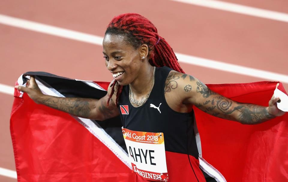 michelle lee ahye trinidad flag olympian commonwealth games champion 100 meteres