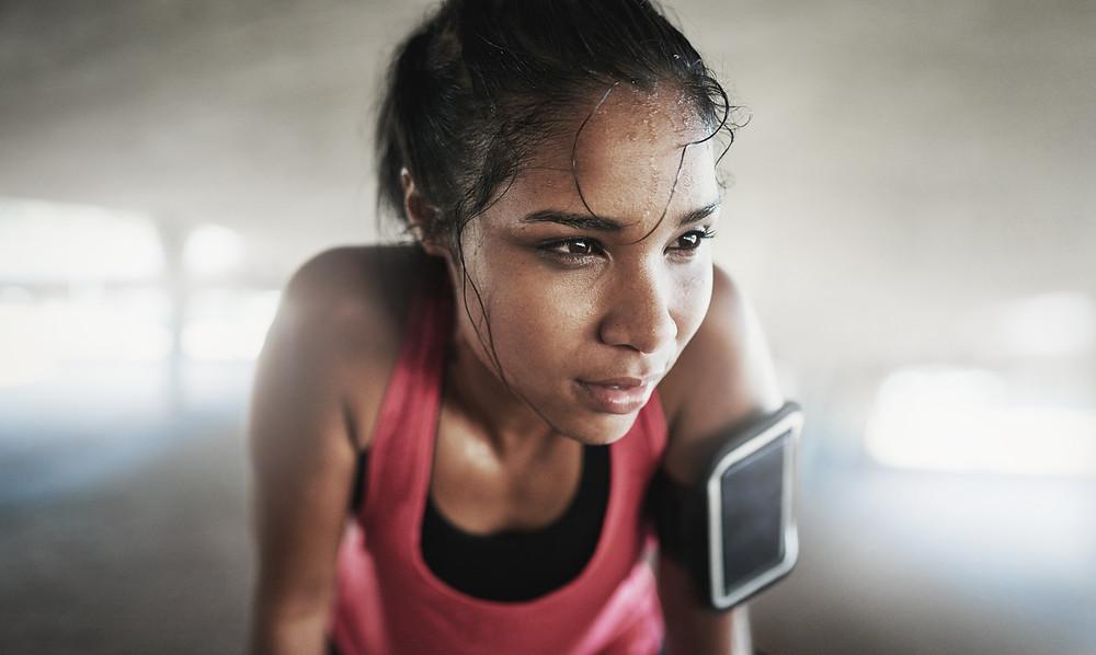 Inspired women athlete fitness trainer