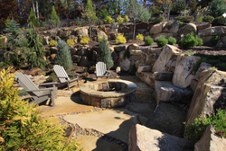 Natural stone terrace and firepit