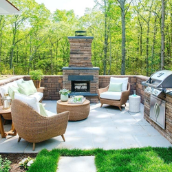 Cozy patio, fireplace and grill comb