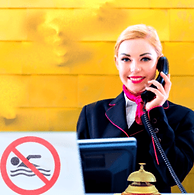 hotel-receptionist-with-phone-front-desk