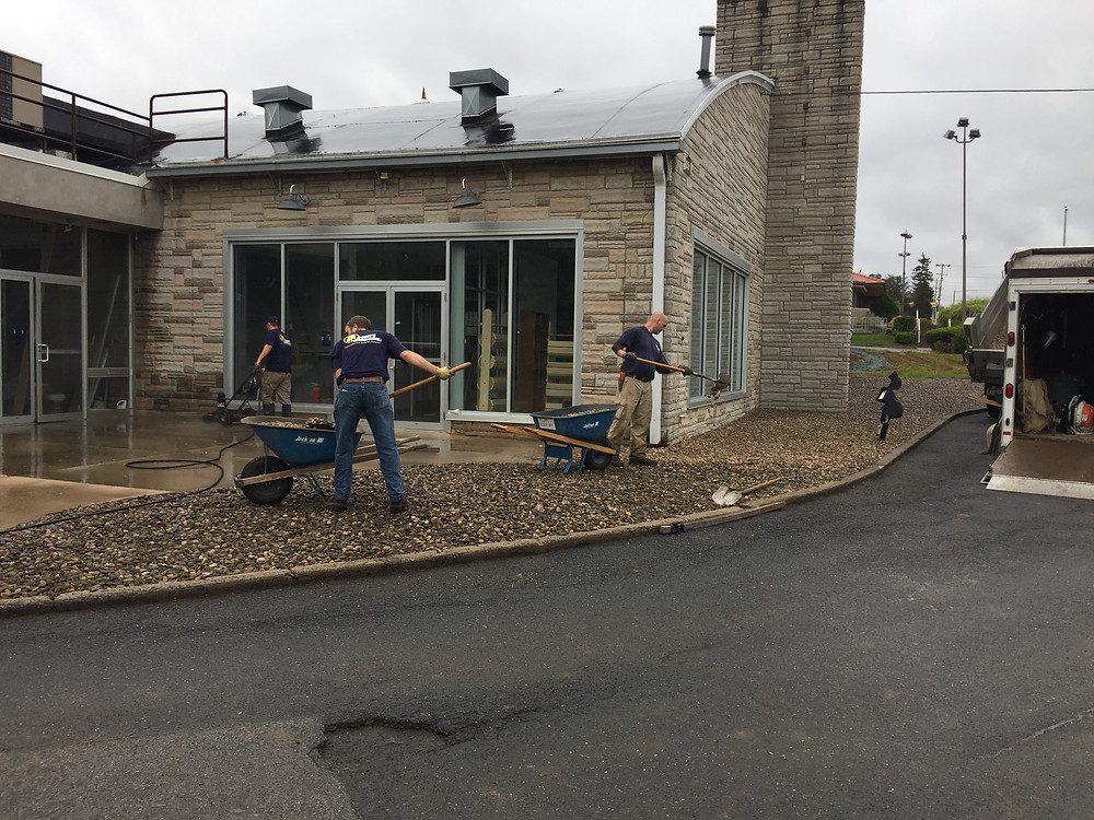 Scott's Team power washing during the 2017 Day of Caring