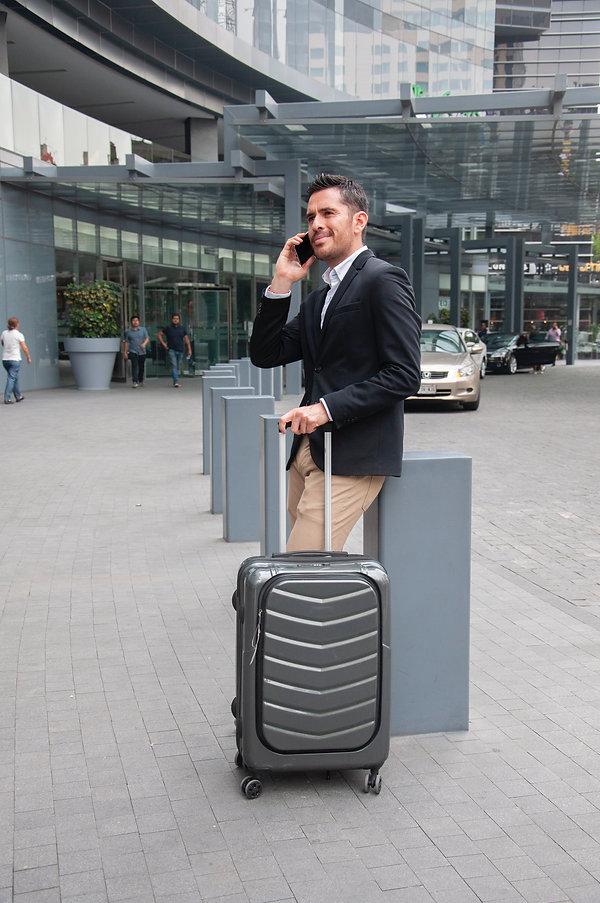 amn-holding-luggage-bag-2229526.jpg