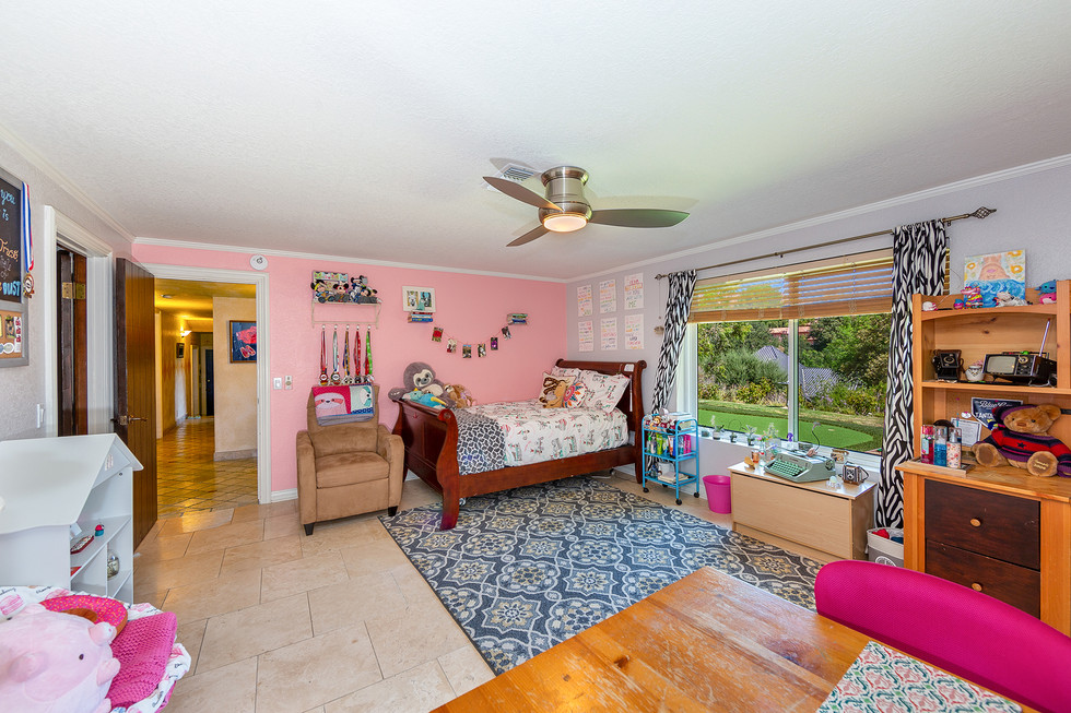 Large Bedroom with Walk-in Closets and Outdoor Access
