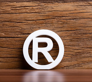 Registered%20Trademark%20Sign%20In%20Front%20Of%20Wooden%20Wall_edited.jpg