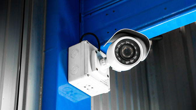 security camera at secure vehicle wrapping facility excelsus solutions