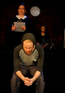 """A scene from the Theatre Three (NY) production of """"Ok Computer,"""" a dark one-act comedy about a future society where computer dating has become mandatory, written by Alaskan playwright Tom Moran.."""