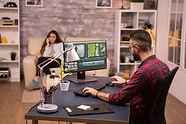 creative-videographer-editing-a-movie-on