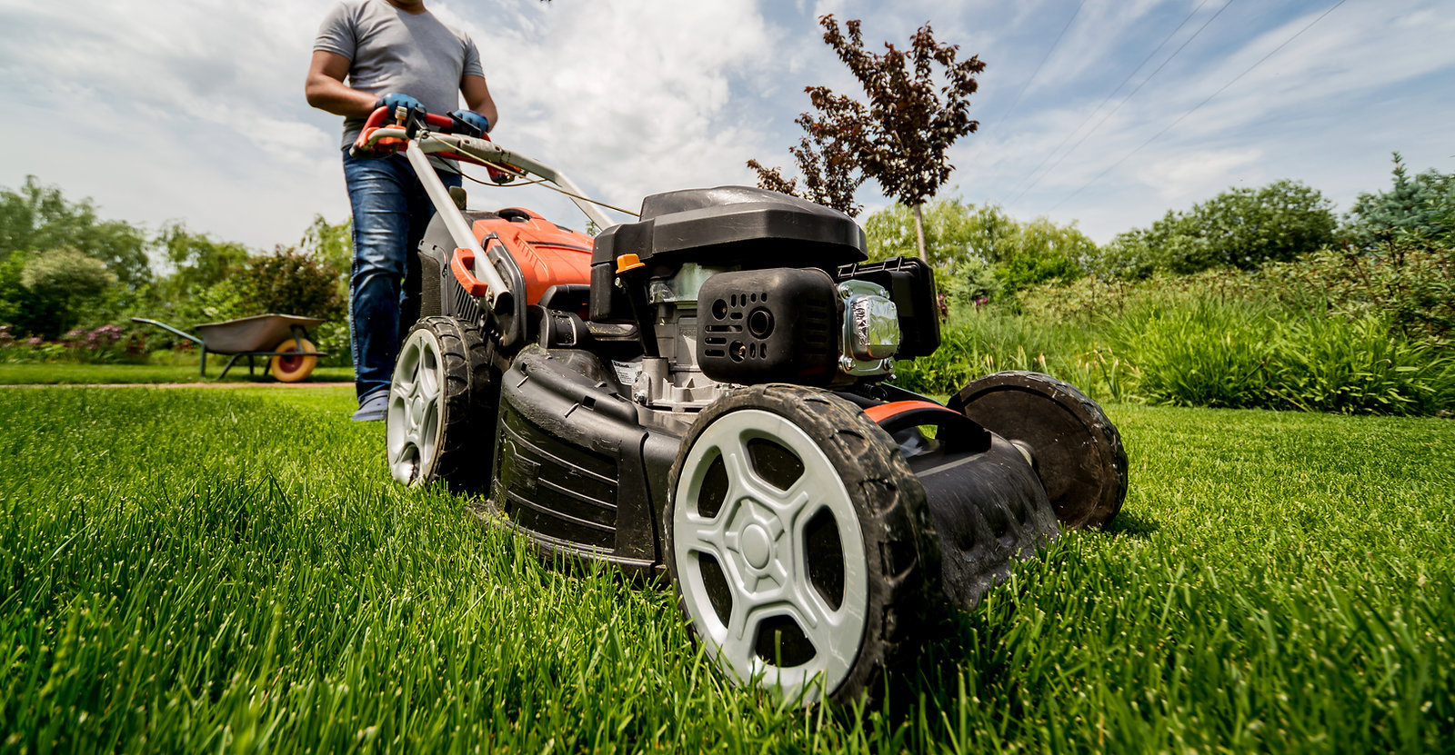 gardener-mowing-the-lawn-landscape-desig