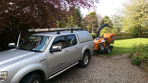 The Ford Ranger towing a Forst TR6 wood chipper.