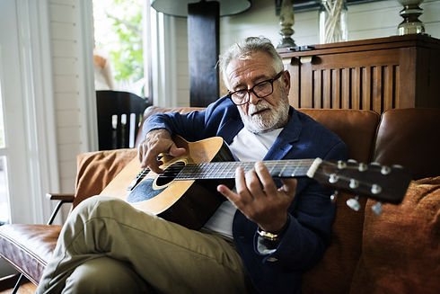 An elderly man is playing guitar.jpg
