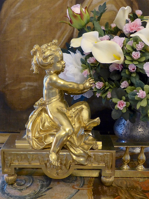 Paire de chenets aux putti en bronze doré, époque NIII, XIXe