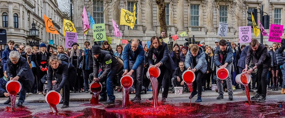 Extinction Rebellion peacefully pour 'blood' onto the streets outside Downing Street