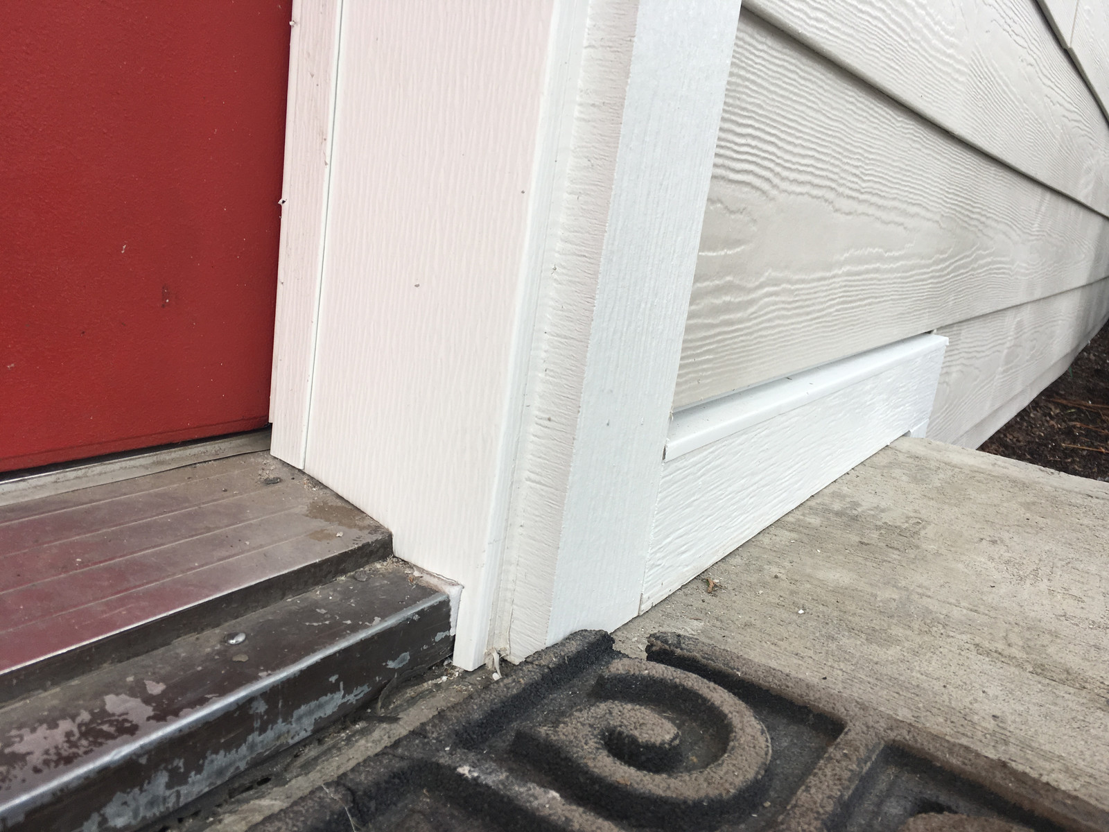 Custom bent coil flashing on inside of door jamb