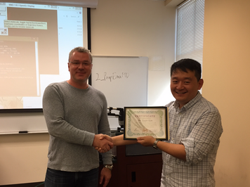 Dr. Afonin presents Dr. Taejin Kim with a certificate following his RNA modeling lecture for CHEM 4090