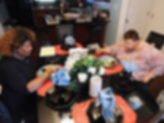Two women eat dinner together in a home