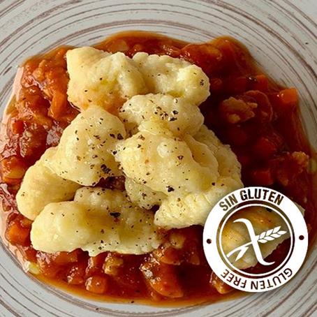 Gnocchi de papa con salsa de tomate y cerdo