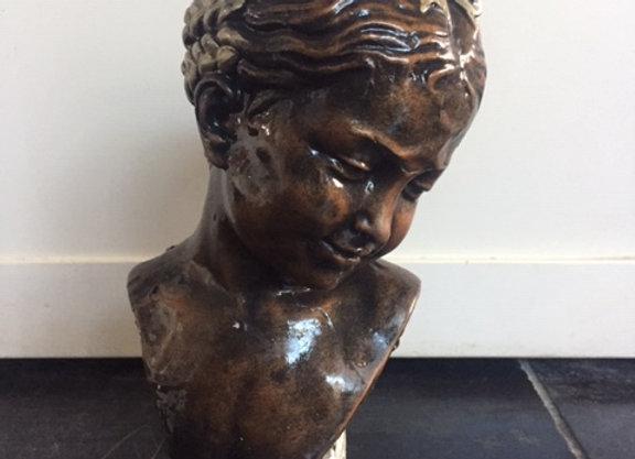 hoofd van meisje gips met bronskleur
