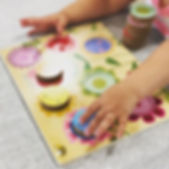 Preschool student playing with a puzzle.