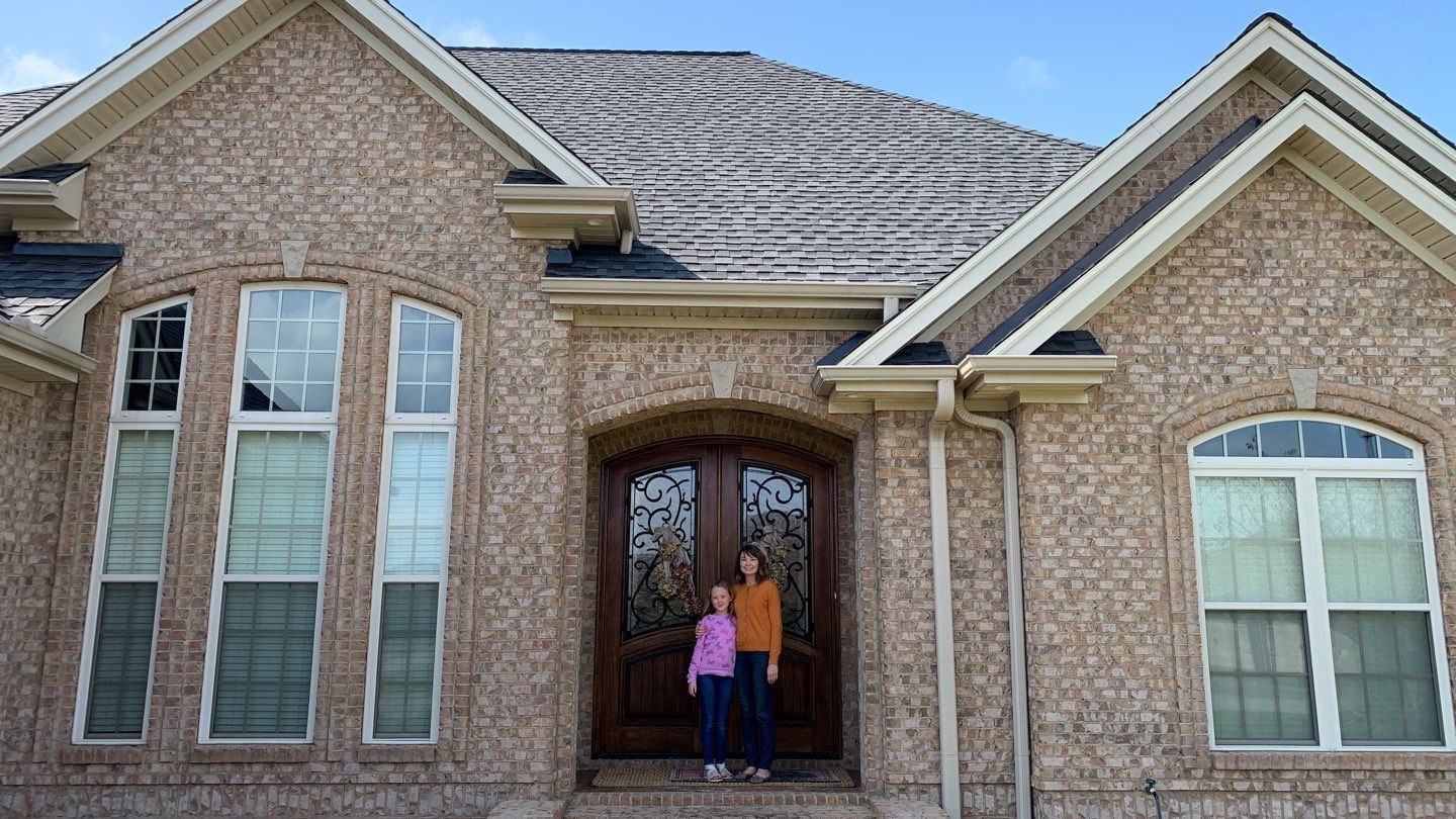 Happy Homeowners with their new roof!