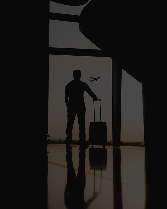 silhouette%20of%20man%20holding%20luggage%20inside%20airport_edited.jpg