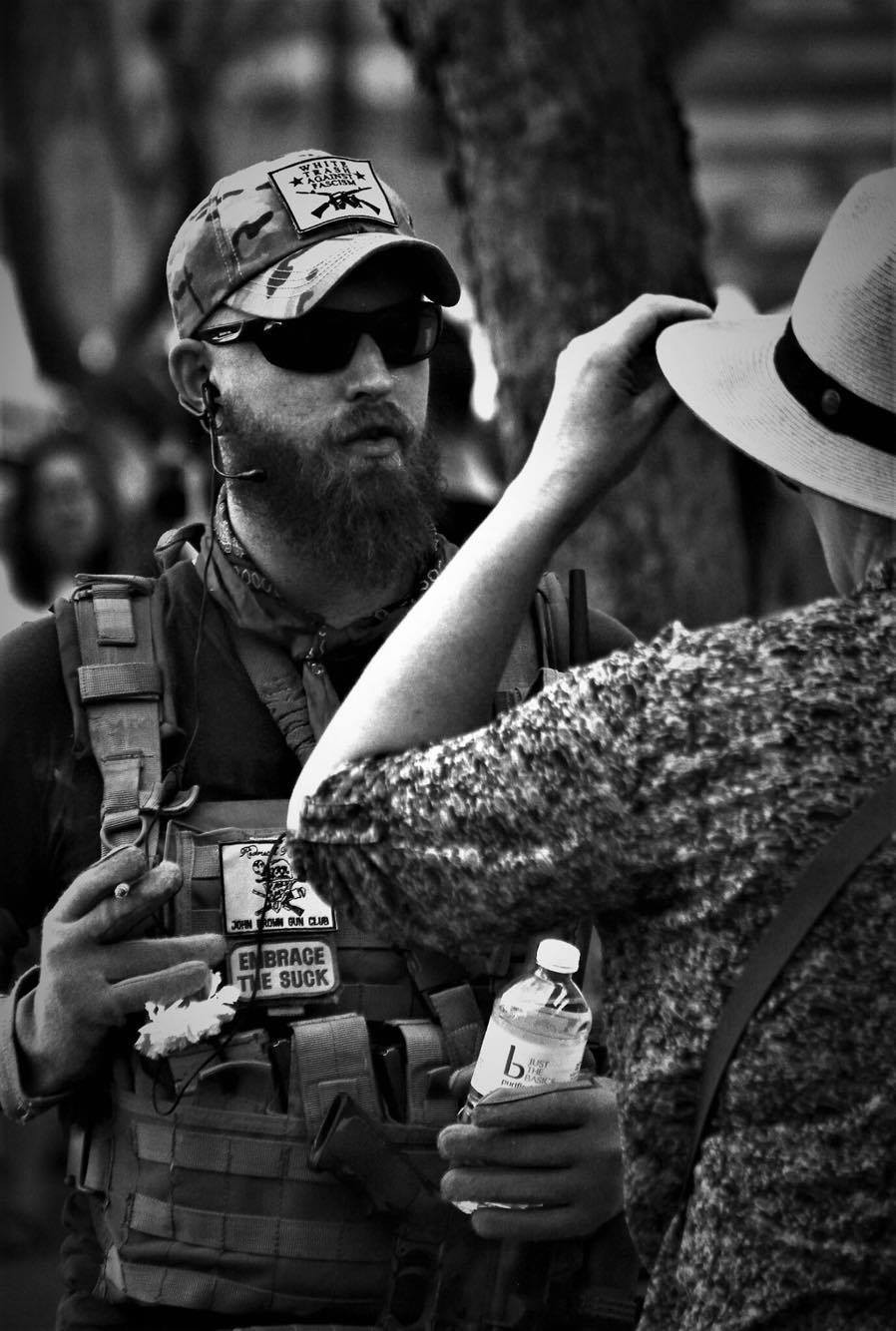 Trump supporter with hand on sidearm
