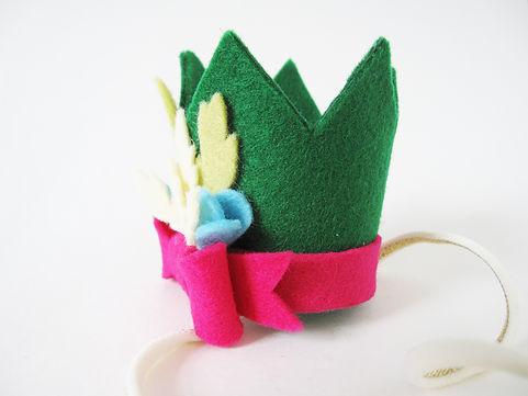 kroon groen met roze strikje blauwe bloe