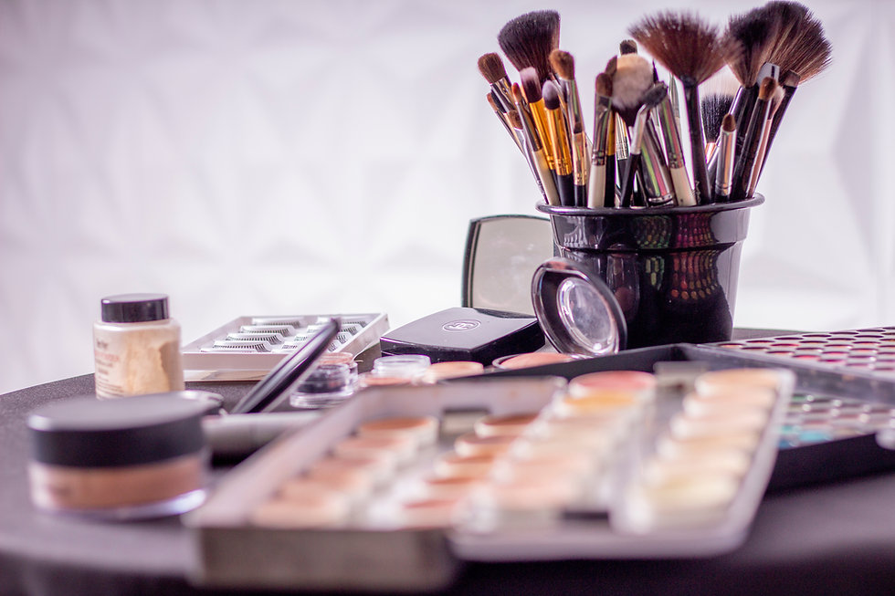 Canva - Makeup Brush on Black Container.