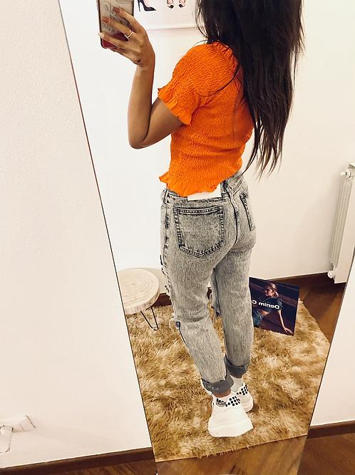 Jeans grigio strappi