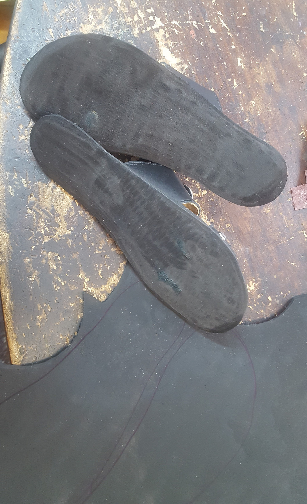A layer of 2 mm soft sole has been glued to the bottom of the sandal and sanded flat