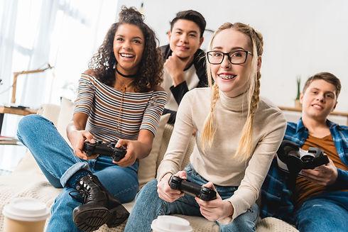 happy teenage multiethnic girls playing