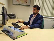 Dharmin at Desk 2.jpg