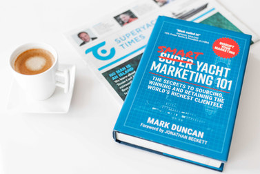 Smart Yacht Marketing 101 book and SuperYacht Times - picture from SYT