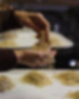 Ramen noodle in cook's hands - photograph by Pak Keung Wan