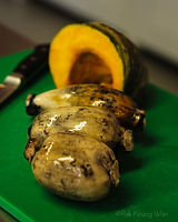 Lotus roots and kabocha on cutting board - photograph by Pak Keung Wan