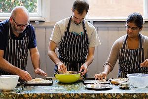 three cooks preparing katsu at chef Sachiko Saeki's Gyoza and Katsu masterclass - photograph by Pak Keung Wan
