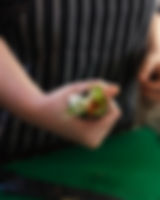 Temaki sushi bouquet gripped in fleshy hand - photograph by Pak Keung Wan
