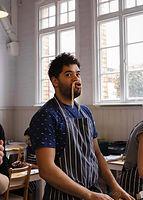A man wears ramen noodle like a moustache - photograph by Pak Keung Wan