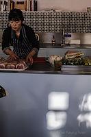 Chef Sachiko Saeki prepping with sunlight - photograph by Pak Keung Wan