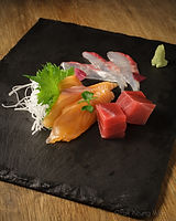 Sashimi platter on slate - photograph by Pak Keung Wan