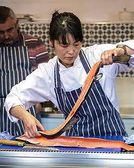 Chef Sachiko Saeki filleting salmon
