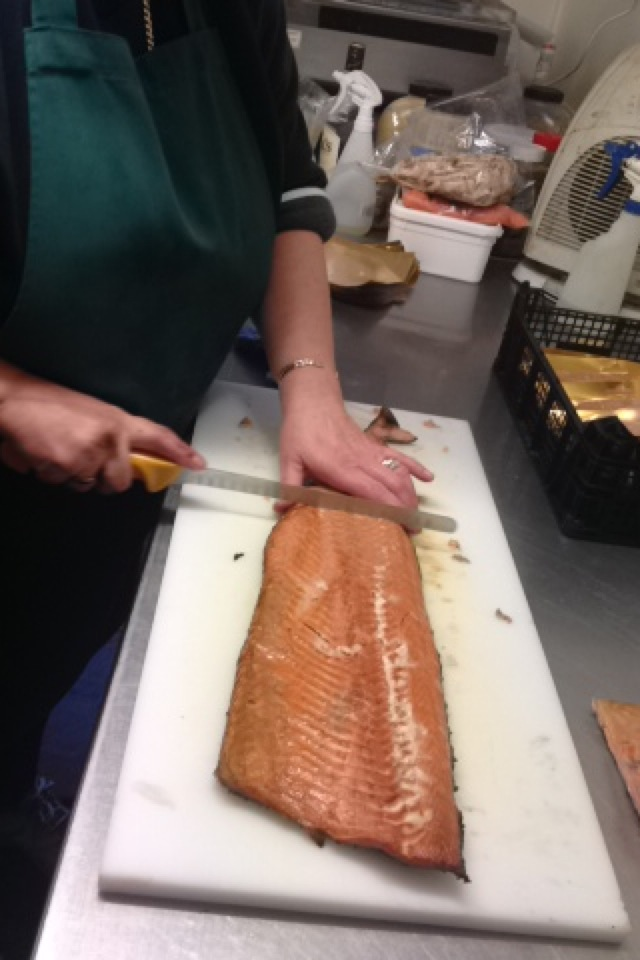 Slicing Oak Roasted Salmon