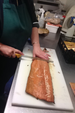 Slicing Oak Roasted Salmon