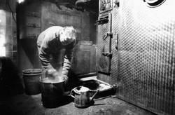 Preparing the smoker with sawdust