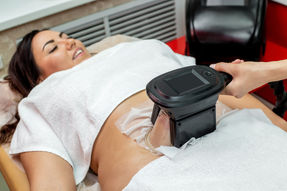 Woman getting cryolipolysis fat treatmen