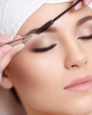 Permanent makeup. Beautiful young woman