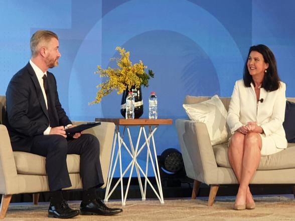 Jane Hume & PK seated on stage.jpg