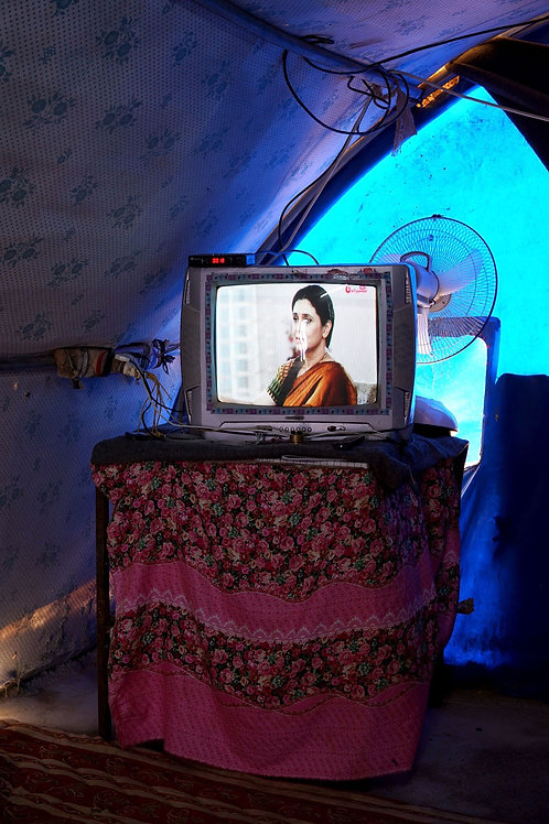 A TV playing an Indian soap - Quyyarah, Iraq (August 30, 2018)