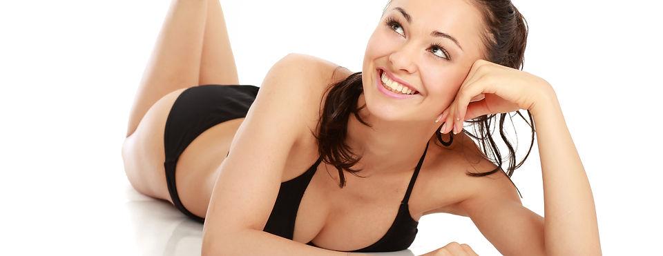 A beautiful smiling woman in a black swi